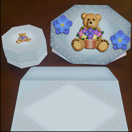 stand up bear card in blue with envelope and gift box