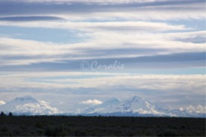 the three sisters mountains in blue