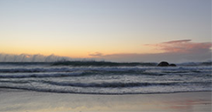 sunset, waves and wind at camps bay