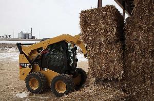 cat skid loader in action