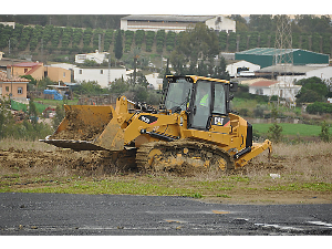 caterpillar track loader in action