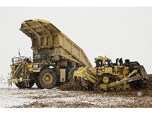 caterpillar dozer in action