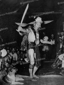 kenyah warrior performing a headhunting-dance, 1952