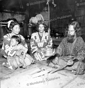 ainu family in their house, yezo, h.c. white, 1905