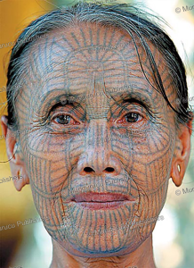 chin woman with traditonal face tattoo, burma, 1972