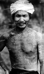 shan man fully tattooed with magical squares for protection, burma