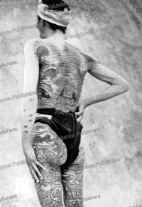 palaung man, showing his tattoos and charms, burma, leslie milne, 1924