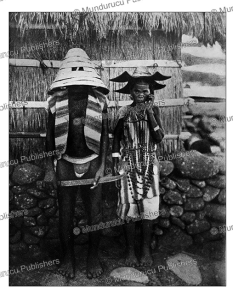 Man and woman of Formosa wearing hats for the springfestival, J.B.M. McGovern, 1923 | Photos and Images | Travel