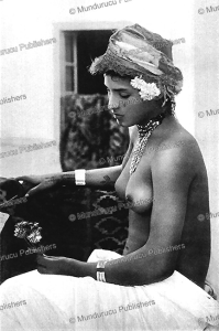 Berber girl with tattoo marks on her arms and cheeks, 1929 | Photos and Images | Travel