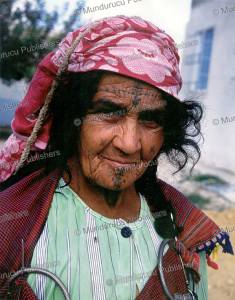 Berber woman with the traditional sayala and foula tattoo patterns, Tunisia | Photos and Images | Travel