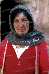 matmata berber woman with traditonal foula design, tunisia