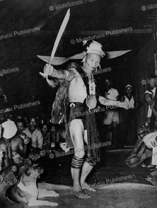 Kenyah warrior performing a headhunting-dance, 1952 | Photos and Images | Travel