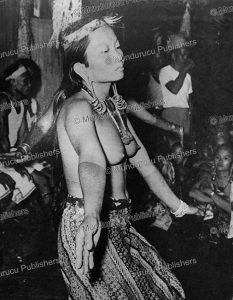 Young Kenyah dancer with tattooed hands and arms, 1952 | Photos and Images | Travel