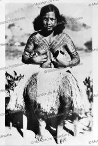 papua woman suckling dogs, 1954