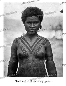 Koita girl showing v-shaped gado design, Papua New Guinea, C.G. Seligmann, 1910   Photos and Images   Travel