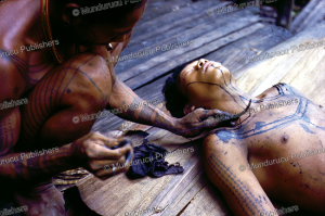 Outlining the tattoo design, Mentawai, Reimar Schefold, 1982 | Photos and Images | Travel