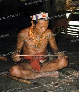 mentawai man making a tattoo tool, mantawai, marco bratt, 1980