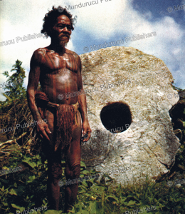 Tattooed man of Yap before a huge money stone | Photos and Images | Travel