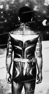 A man from Yap Island with a traditonal back tattoo | Photos and Images | Travel