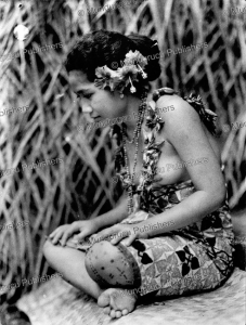 the village virgin (taupo) with tradional tattoos, samoa, 1925