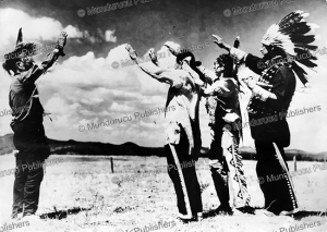 Sioux Indians performing a rain dance by lifting their arms to the sky | Photos and Images | Travel