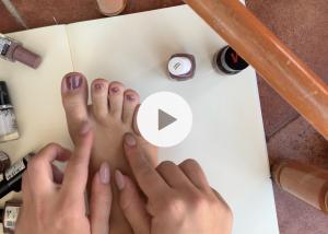 close up video of my feet - applying nail polish and massaging them