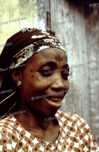 Yoruba woman with tribal tattoo marks on her face, Nigeria | Photos and Images | Digital Art